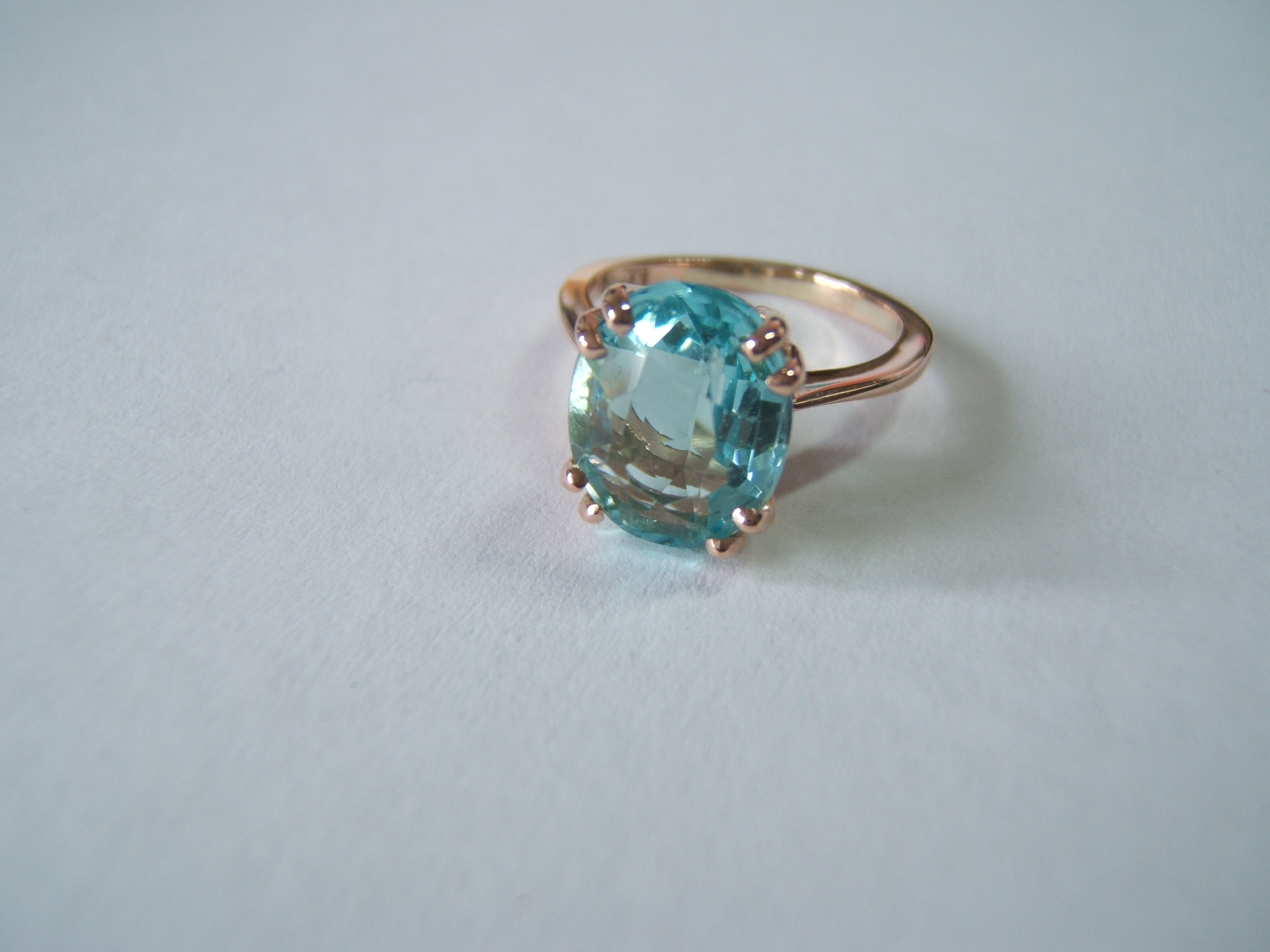 rose gold ringset with a beautiful;faceted topaz by helen burrell