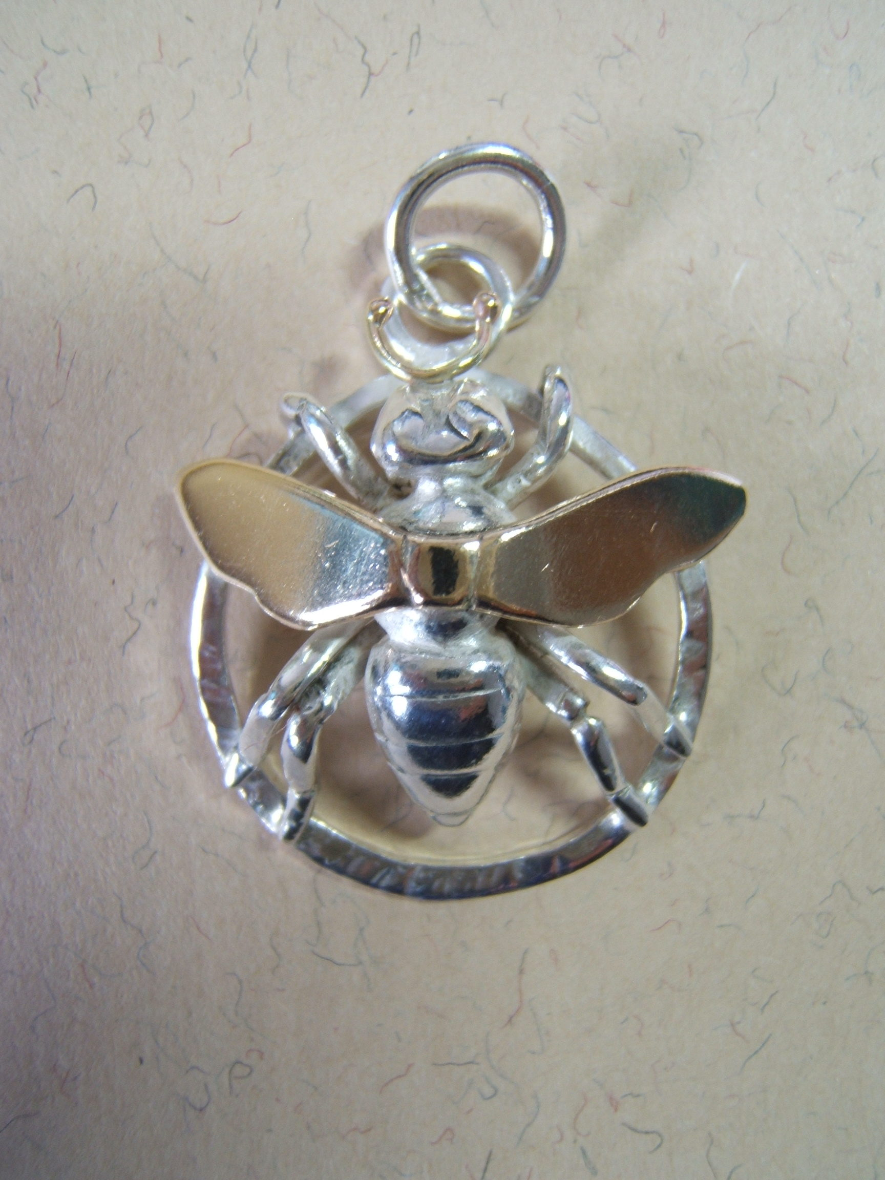 silver and gold bee pendant by helen burrell