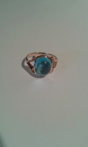 Topaz cabochon set in rose gold