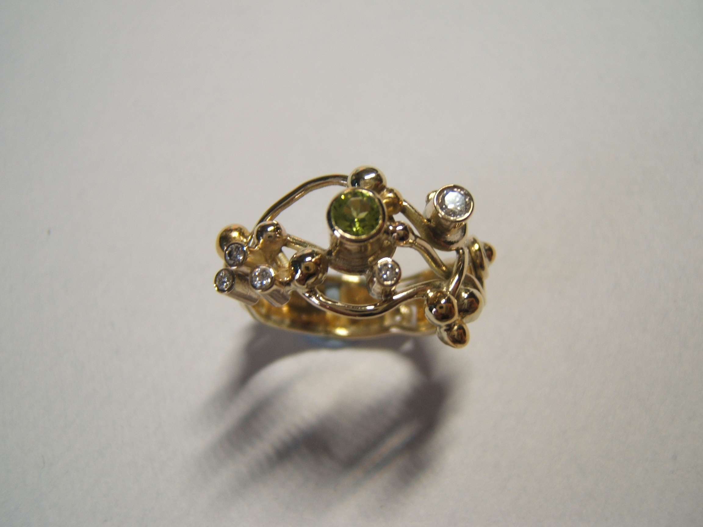 peridot and diamonds ring designed and created by helen burrell