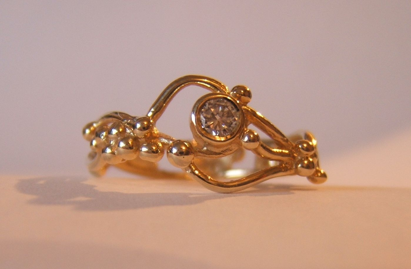 18ct gold ebb and flow ring by helen burrell