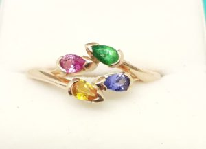 <imgsrc='double pear rings by helen burrell'alt= doulble pearshaped stones set in gold rings that interlink with each other'>